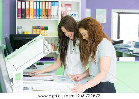 Young Students At A Copy Center
