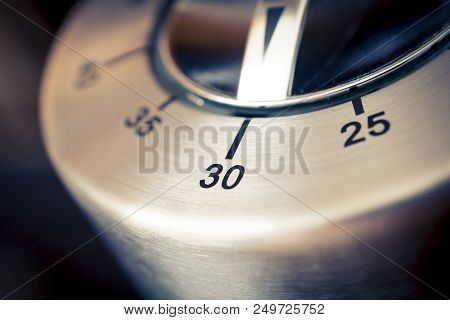30 Minutes - A Macro Of An Analog Chrome Kitchen Timer With Dark Background