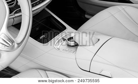Media And Navigation Control Buttons Of A Modern Car. Car Interior Details. White Leather Interior O