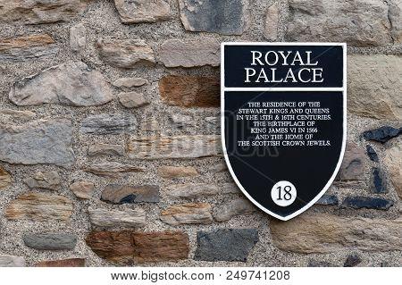 Edinburgh, Scotland - April 2018: Information Sign Of Royal Palace On A Stone Building Wall Inside E