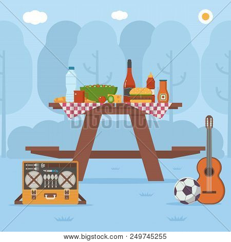 Summer Wooden Picnic Table On Forest Background. Family Barbecue Concept With Picnic Party Stuff. Gu
