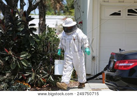Lake Forest, California 7-16-2018: Scenes from an Emergency Response to a Bee Attack sending 1 cleaning lady to the hospital with critical conditions along with 4 firefighters with various injuries