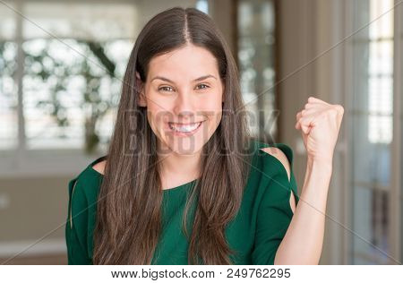 Young beautiful woman at home screaming proud and celebrating victory and success very excited, cheering emotion