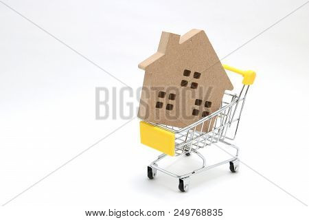 Shopping Cart And House On White Background. Buying New House, Real Estate And Home Mortgage Concept