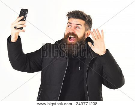 Blogger With Beard Takes Selfie Photo Or Streaming Video. Video Blog And Content Concept. Man With H