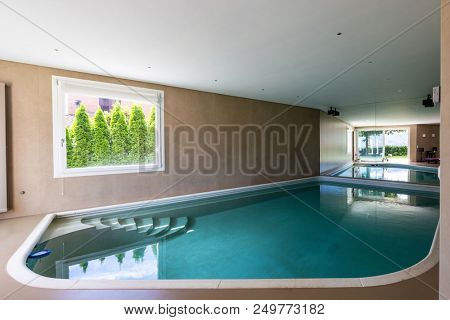 Indoor pool in modern villa just renovated. Nobody inside
