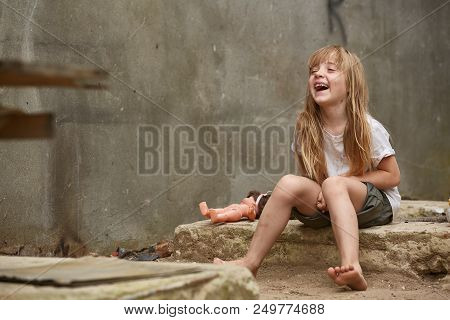 Cute Stray Child On The Street Laughing And Having Fun In Front Of The Camera. Poor Blondy With Matt