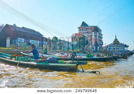 Nyaungshwe, Myanmar - February 19, 2018: The Row Of Moored Canoe Boats, Waiting For Turists To Make