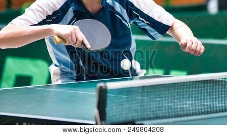 Table Tennis Player returning ball