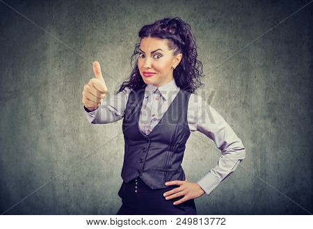 Young Business Woman Showing Thumbs Up Gesture Looking At Camera With Overconfidence