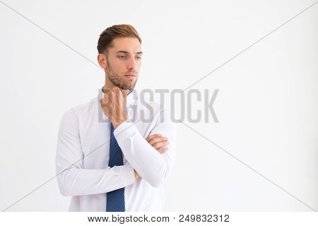 Pensive Business Leader Touching Chin And Looking Away. Attractive Man Thinking. Contemplation Conce