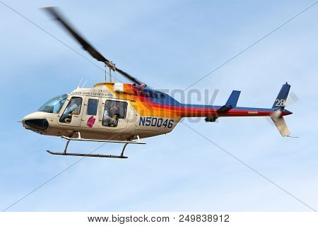 Grand Canyon, Usa - April 3, 2014: Tourists Ride In Papillon Helicopters Flightseeing In Grand Canyo