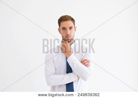 Thoughtful Business Man Touching Chin And Looking At Camera. Handsome Guy Thinking. Contemplation Co