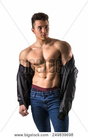 Handsome Young Muscular Man Shirtless Wearing Jeans, Taking Off Leather Jacket On Naked Muscle Torso