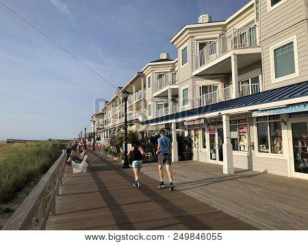 Bethany Beach, De: People Running, Walking And Relaxing On The Boardwalk In Bethany Beach, Delaware