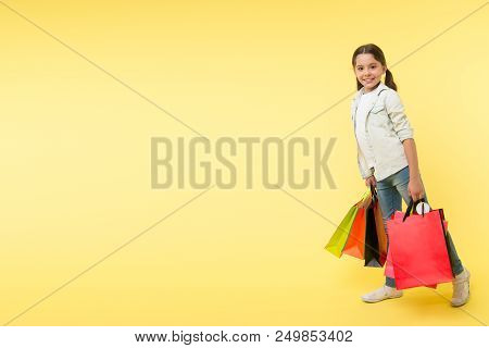 Shopping Day. Shopping Day With Happy Child. Smiling Little Girl On Shopping Day. Girl With Packages