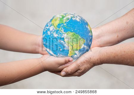 Earth On Baby Hand Idea Of Handing Over The World On The Hands Of New Generation Children In The Fut