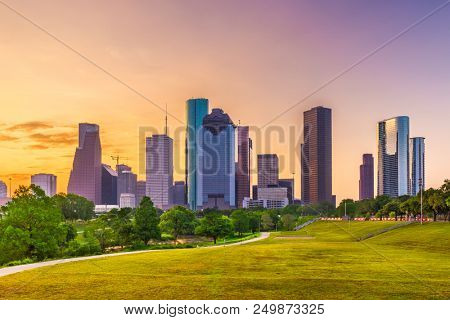 Houston, Texas, USA skyline and park at dusk.