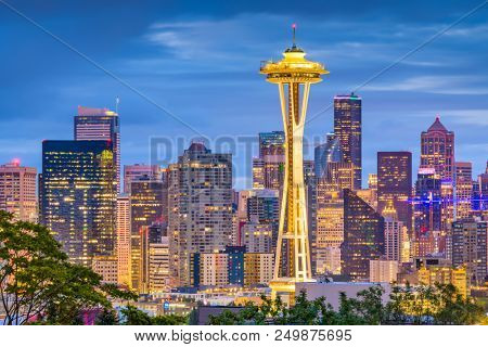 SEATTLE, WASHINGTON - JUNE 26, 2018: The Space Needle towers in front of the downtown Seattle skyline at dusk.