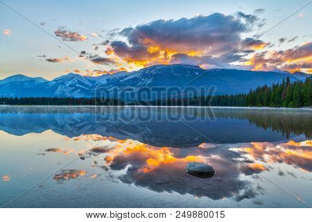 Morning Sun Breaks Out Over The Rocky Mountains At Edith Lake In Jasper National Park.