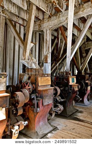 Equipment From A Very Old Grist And Flour Mill Are Left In Tact In A Very Historic And Primitive Bui