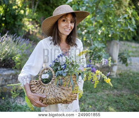 Woman Collecting Plants For Tinctures Plants And Essential Oils