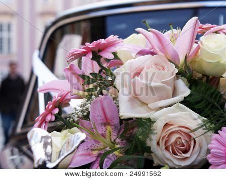 wedding bouquet on black car