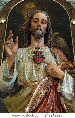 ZACRETJE, CROATIA - AUGUST 06: Sacred Heart of Jesus, altarpiece in the Parish Church of the Holy Cross in Zacretje, Croatia on August 06, 2017.