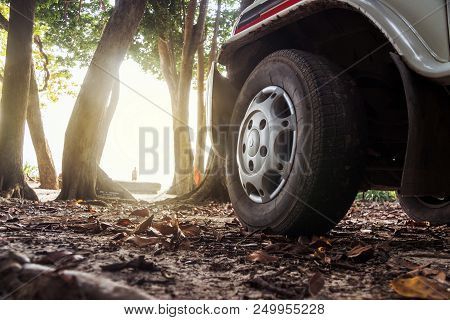 Car Wheels On A Road. Off-road Tire. Outdoor, Adventures And Travel Suv. Close-up Of Car Wheel On Ro