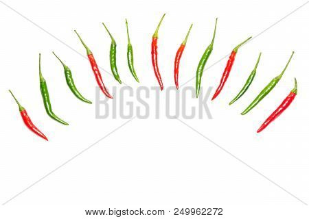 Semicircular Frame Of Red And Green Chili Peppers On White Background. Top View, Copy Space