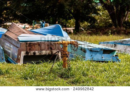 Old Fishing Boat On Green Grass Of Golfito, Costa Rica. Day To Day Life In The Small Village Of Golf