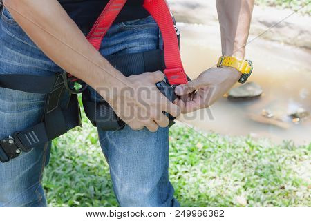 Work Safe Background Concept.soft Focus Close Up Young Man Asian Wear The Safety Harness For Job At