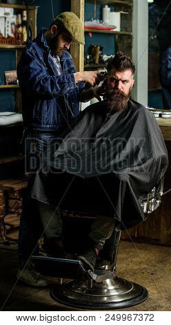 Hipster Lifestyle Concept. Hipster Client Getting Haircut. Barber With Clipper Trimming Hair On Temp