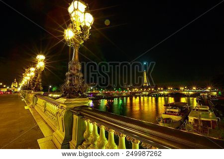 Paris, France - July 2, 2017: Paris Lights On In Pont Alexandre Iii Bridge With Lighted Lamps. Frenc