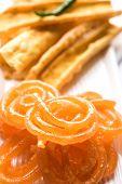 Crispy Fafda with sweet jalebi is an Indian snack most popular in Gujarat, selective focus poster