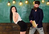 Man with beard slapping sexy student, chalkboard on background. Girl on guilty and helpless face punished by teacher. Schoolmaster punishes sexy student with slapping on her buttocks. Sex game concept poster