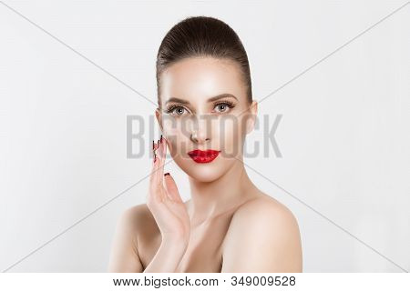 Beauty With Flawless Skin. Natural Brunette Model Posing Looking At Camera On White Background.