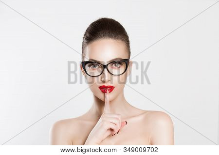 Woman Wide Eyed Asking For Silence Secrecy With Finger On Lips Hush Hand Gesture White Isolated Back