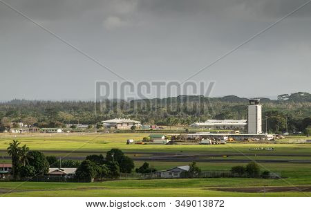 Hilo, Hawaii, Usa. - January 14, 2020: Green Airport With White Control Tower And Buildings Under Da