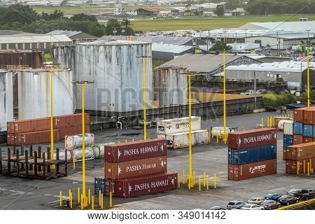 Hilo, Hawaii, Usa. - January 14, 2020: Closeup Of Stacks Of Maroon Pasha Shipping Containers In Fron