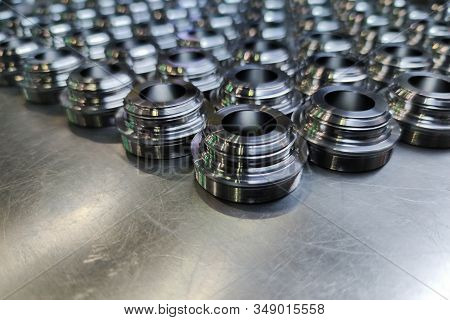 A Batch Of Shiny Metal Cnc Aerospace Parts Production - Close-up With Selective Focus For Industrial