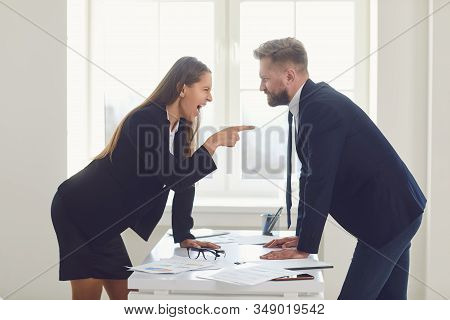 Business Conflict. Competition Conflict Dispute Business Angry People At A Table In An Office