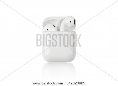 Rostov-on-don, Russia - December 2019. Apple Airpods On A White Background. Wireless Headphones In A