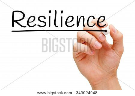 Hand Writing The Word Resilience With Black Marker On Transparent Wipe Board Isolated On White.