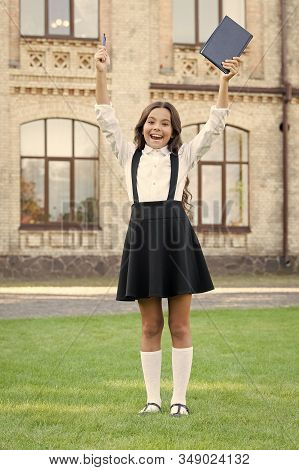 Hurray For School Holidays. Happy Child Finish Primary School. Cute Little Girl Celebrate In Formal