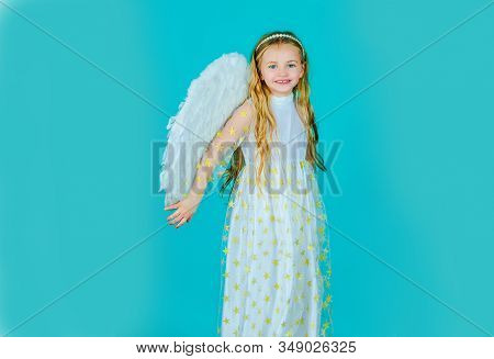 Happy Little Angel. Angel Child. Cute Child Girl Posing With Angel Wings. Child Angel With A Beautif