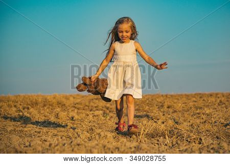 Adorable Kid Having Fun. Cute Young Girl. Little Child Have Fun On Fresh Air. Child Has Summer Joy.