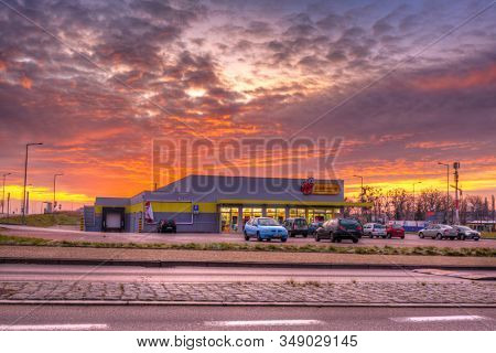 Pruszcz Gdanski, Poland - January 2, 2018: Biedronka supermarket in Pruszcz Gdanski at sunrise, Poland.  Biedronka (Ladybug) is  the largest supermarket chain in Poland owned by  Jeronimo Martins.