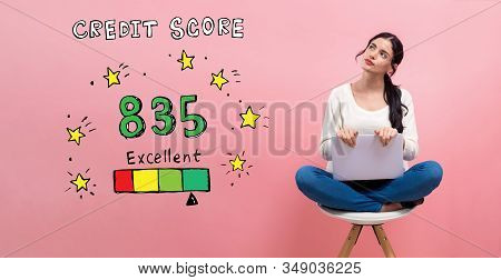 Excellent Credit Score Theme With Young Woman Using A Laptop Computer