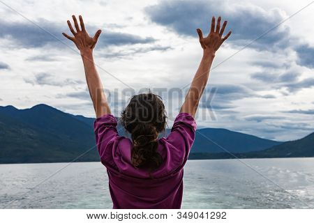 Close Up From Behind Of A Man On The Deck Of A Passenger Ferryboat. Arms Raised And Hands With Finge